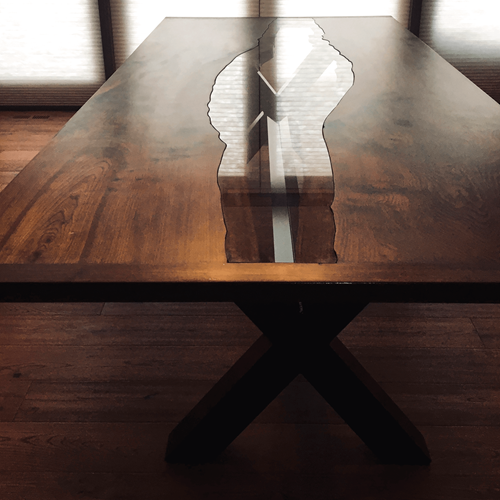 Glass set into a custom made raw edge table with custom metal legs.