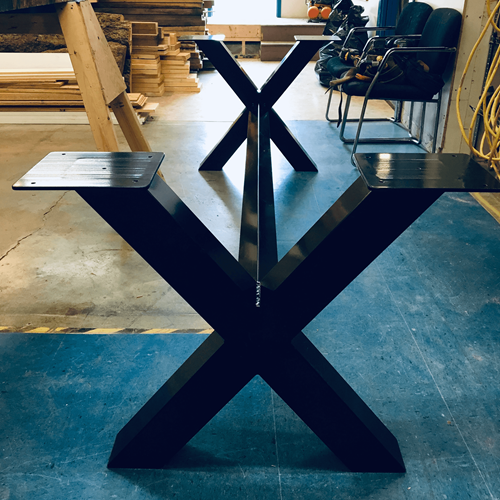 Custom fabricated metal table legs.